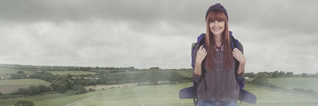 Digital composite of Travelling woman with bag in front of landscape
