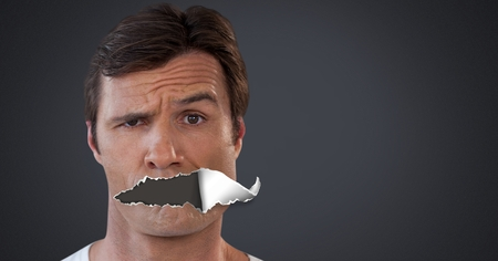 Digital composite of Man with torn paper on mouth