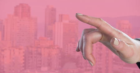 Digital composite of Hand pointing with pink background Stock Photo