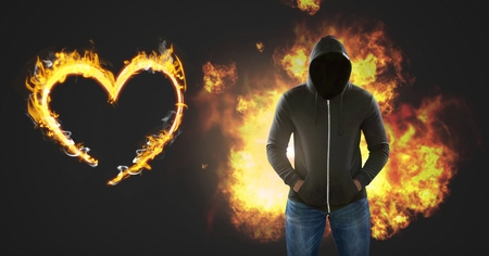 Digital composite of Dark Man with no face and burning fire flames with heart Stock Photo