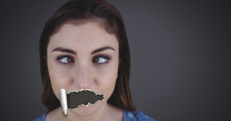 Digital composite of Woman with torn paper on mouth Stok Fotoğraf - 97244836