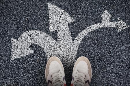 Focus of sport-wear shoes  against black road 写真素材