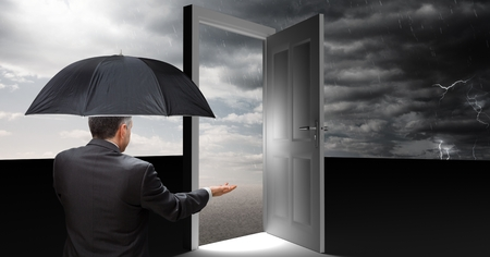 Digital composite of man holding umbrella and open door with surreal grey cloudy sky