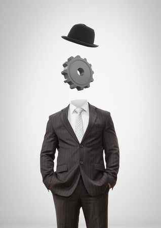 Digital composite of Headless man with surreal floating hat and cog gear