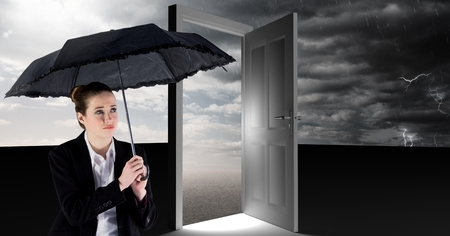 Digital composite of woman holding umbrella and surreal open door with grey cloudy sky