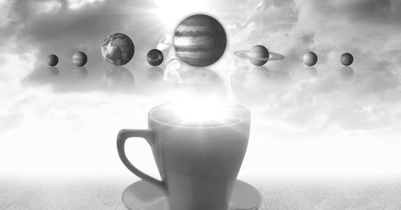 Digital composite of Cup of tea with surreal solar system planets and clouds Stock Photo