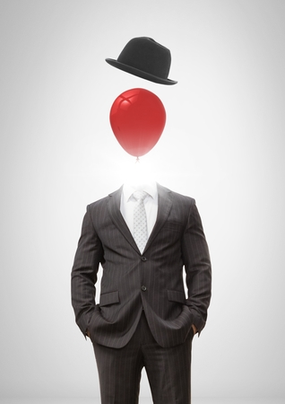 Digital composite of Headless man with surreal floating hat and balloon