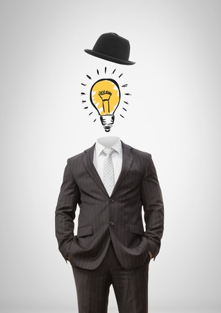 Digital composite of Headless man with surreal floating hat and light bulb