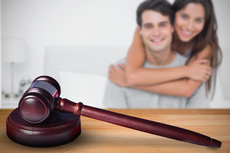 Woman embracing her partner against hammer and gavel