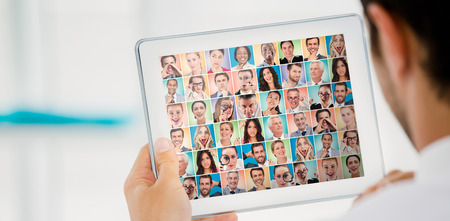 People collage portrait very wide against cropped image of businessman holding digital tablet