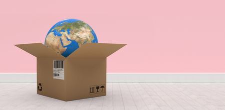Digital composite 3D image of globe in brown cardboard box against pink wall by hardwood floor