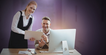 Digital composite of Business couple working on computer