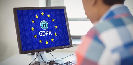 European Union locked against close-up of schoolboy using computer Foto de archivo