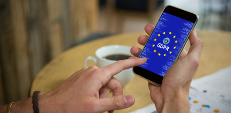 European Union Locked GDPR  against man using mobile phone at table in cafe