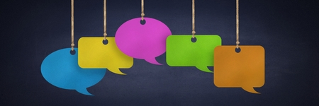 Digital composite of Hanging paper speech bubbles and blackboard background
