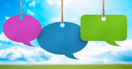 Digital composite of Hanging paper speech bubbles and sky background Stok Fotoğraf