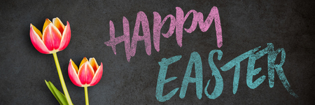Easter greeting against close-up of blackboard Stock Photo