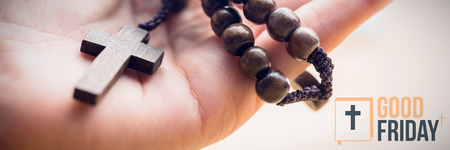 good friday  against hand holding rosary beads Stock Photo