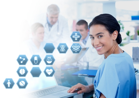 Digital composite of Female doctor holding tablet with medical interface hexagon icons