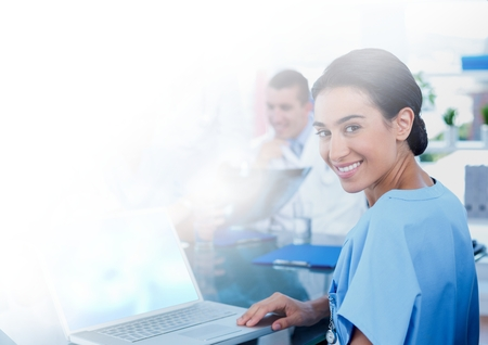 Digital composite of Female doctor holding tablet Stock Photo