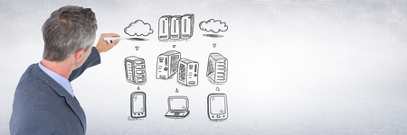 Digital composite of Businessman drawing servers network doodles