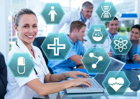 Digital composite of Female doctor working on laptop with medical interface hexagon icons