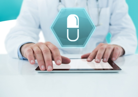 Digital composite of Male doctor holding tablet with medicine tablet drug interface hexagon icon