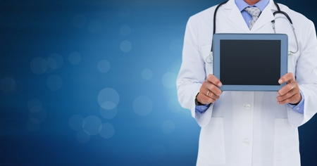 Digital composite of Male doctor holding tablet Stock fotó
