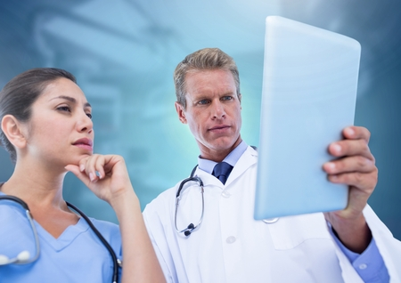 Digital composite of Doctors holding tablet Stock Photo