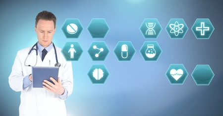 Digital composite of Male doctor holding tablet with medical interface hexagon icons