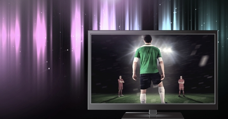 Digital composite of soccer player on television
