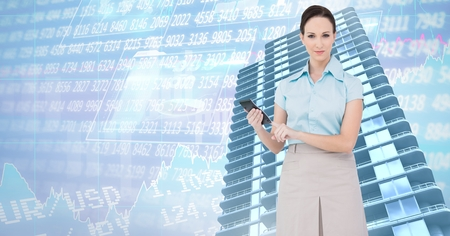 Digital composite of Businesswoman holding phone and Tall buildings with economic finance background Banque d'images - 103187860