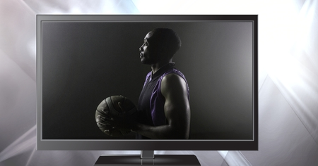 Digital composite of basketball on television