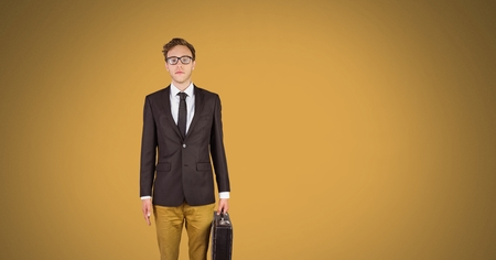 Digital composite of Businessman standing with yellow background