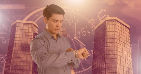 Digital composite of Man checking time on watch and Tall buildings with economic finance background