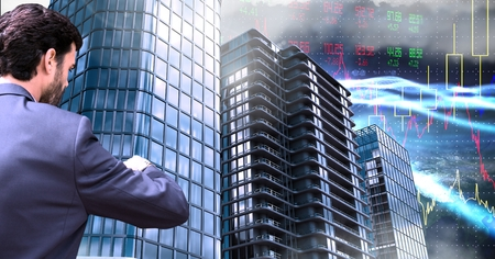Digital composite of Businessman checking watch and Tall buildings with economic finance background Stockfoto