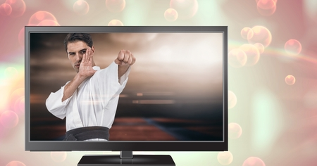 Digital composite of martial arts fighter player on television