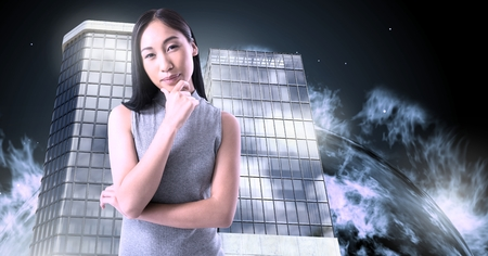 Digital composite of Woman thinking and Tall buildings with planet burning background Imagens