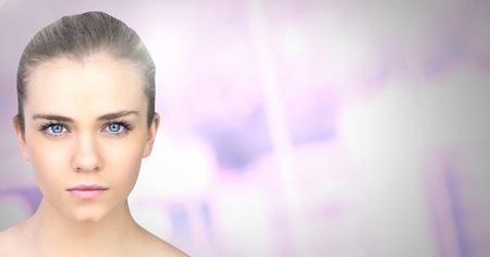 Digital composite of Womans face with blurred purple background Archivio Fotografico - 103412040