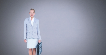 Digital composite of Businesswoman with briefcase