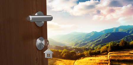 Digitally generated image of brown door with house key against wheat field in mountain