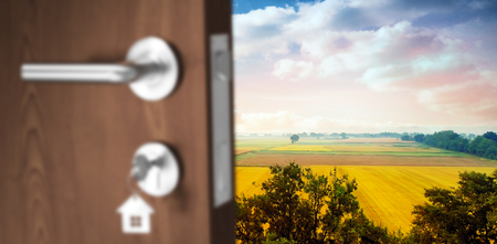 Digitally generated image of brown door with key against landscape of multiple grass field