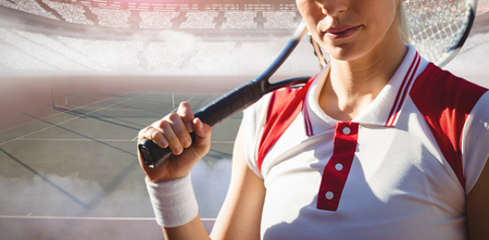 Tennis woman against tennis ball on dividing line Stock Photo