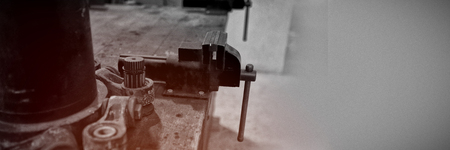 Vise tool on a wooden table at solar station