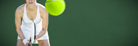 Tennis woman against green background Stock Photo