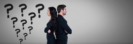 Digital composite of Confused unhappy couple with colorful funky question marks in dark black