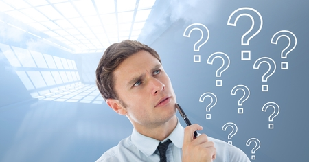 Digital composite of Man thinking with question marks Stock Photo