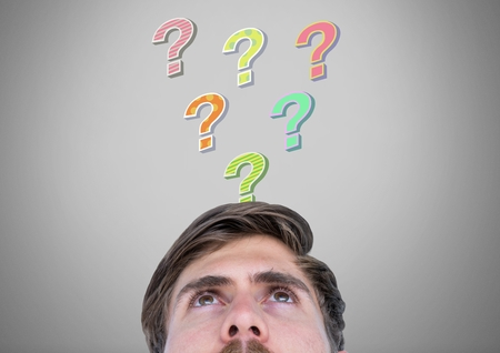 Digital composite of Man with colorful funky question marks emerging from head