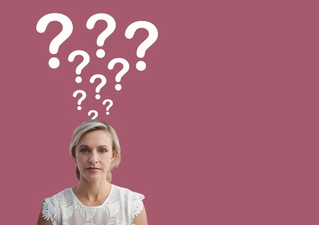 Digital composite of Woman with question marks emerging from head