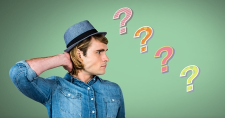 Digital composite of Man thinking with colorful funky question marks